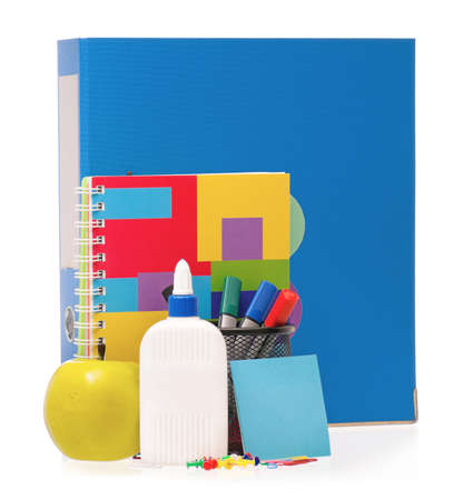 Big blue folder, markers, exercise book and green apple isolated on white background photo