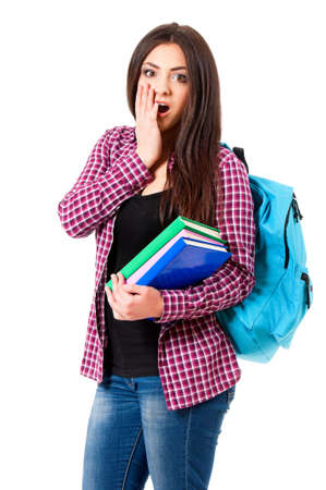 Surprised student girl with backpack and books, isolated on white background Stock Photo - 19811379