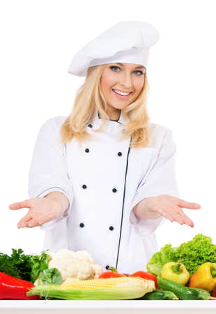 Woman cook in chef hat with fresh vegetables, isolated on white background photo