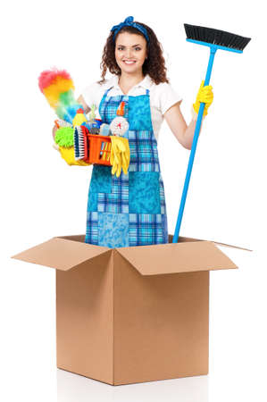 Young housewife with cleaning supplies in cardboard box, isolated on white background photo