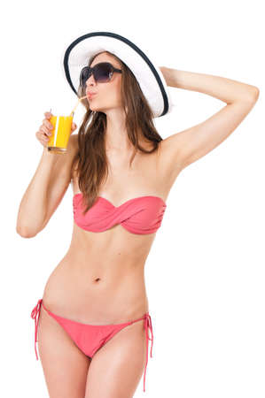 Pretty blonde girl posing in bikini summer hat and sunglasses, isolated on white background photo