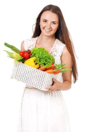 Happy beautiful girl with fresh vegetables, isolated on white background photo