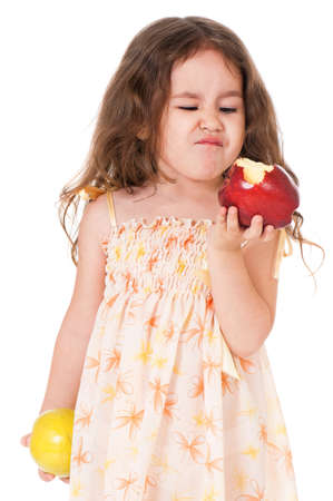 Portrait of little girl with apple, isolated on white background photo