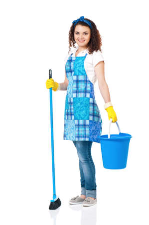 Young housewife with blue bucket and broom, isolated on white background photo