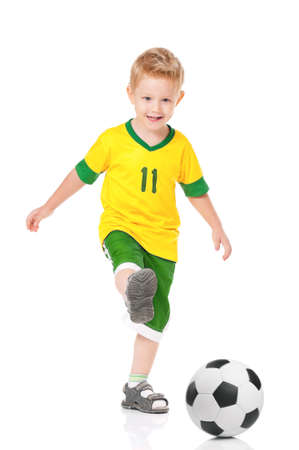 Happy little boy with soccer ball, isolated on white background photo
