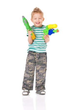 Happy boy with plastic water guns isolated on white background photo