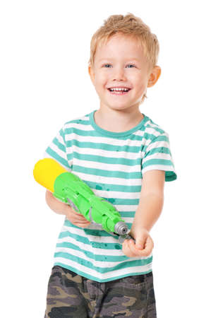 Happy boy with plastic water gun isolated on white background photo