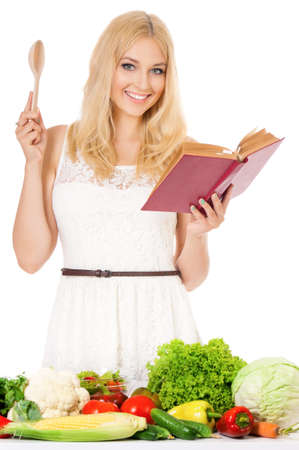 Beautiful woman with recipe book and wooden spoon, isolated on white background photo