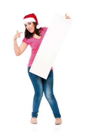 Christmas woman showing blank sign billboard standing in full length, isolated on white background photo