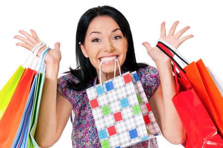 шопоголика: Шопоголик покупки женщина много сумок, изолированных на белом фоне