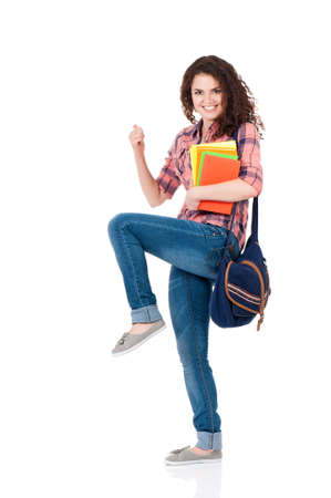 Cheerful student girl with bag and books, isolated on white background photo
