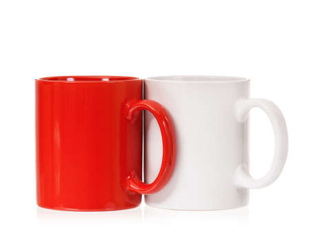Two mugs – white and red, isolated on white background photo