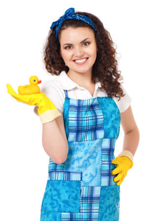 Young housewife with yellow gloves and rubber duckling, isolated on white background photo