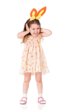 Funny little girl with rabbit ears, isolated on white background photo