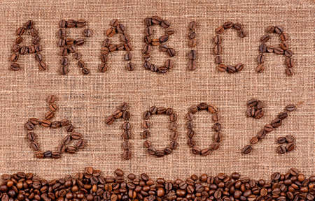 Frame of coffee beans and text hundred percent arabica  photo