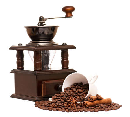 Manual coffee grinder with coffee beans and cup, isolated on white background Stock Photo