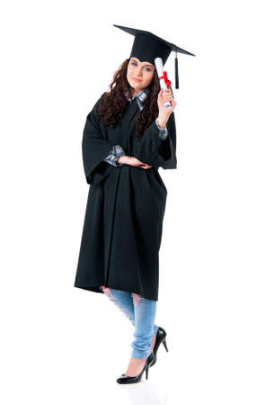 Young graduate girl student in mantle with diploma, isolated on white background photo