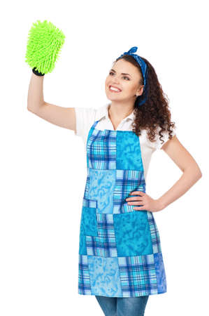 Young housewife with green cleaning cloth, isolated on white background photo