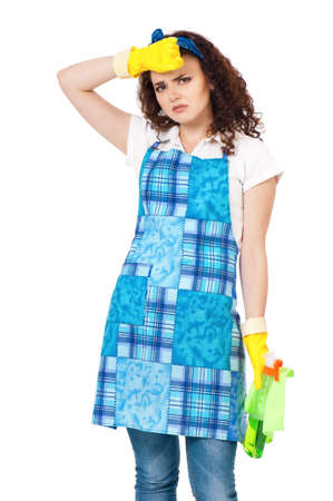 Tired young housewife with yellow gloves, isolated on white background photo
