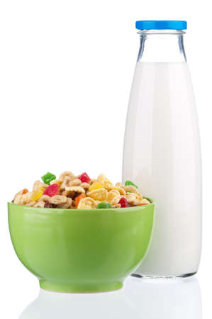 Cornflakes in bowl and milk photo