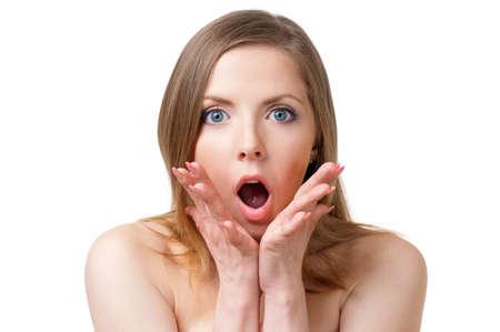 Portrait of a beautiful shocked woman photo