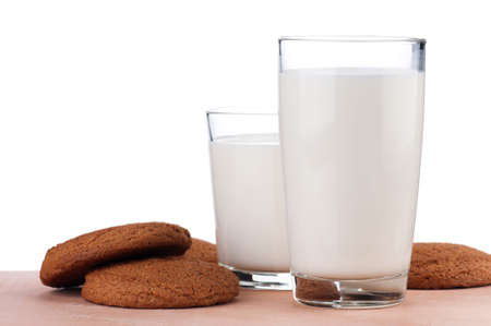 Glass of milk with cookies on white background photo