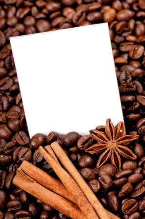 Empty paper on roasted coffee beans, can be used as background photo