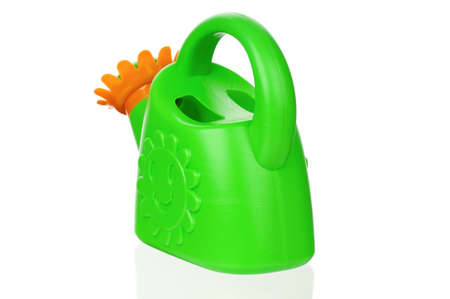 Small green watering can isolated on white background photo