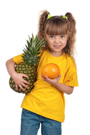 Portrait of happy little girl with pineapple and grapefruit over white background photo