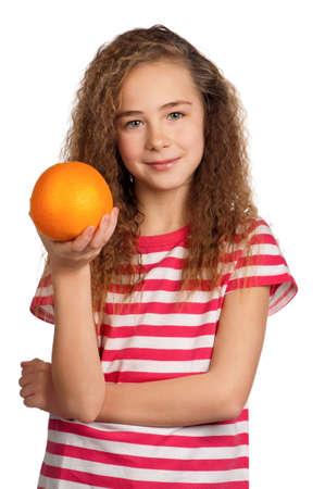 Portrait of happy girl with orange isolated on white background photo