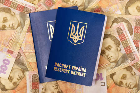 hryvna: Two international Ukrainian passports on Hryvna banknotes background Stock Photo
