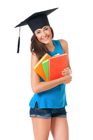 Graduation girl student with books, isolated on white background photo