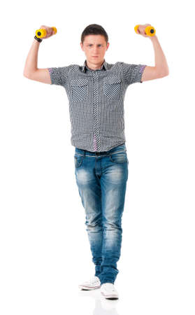 Young man with dumbells - lifting weights, isolated on white background photo