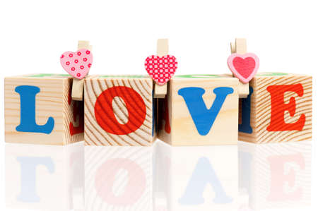 Word love with colorful blocks isolated on a white background photo