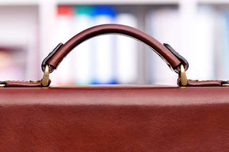 portmanteau: Closeup of brown leather briefcase at office