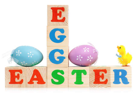 Easter in letter cubes with eggs over a white background photo