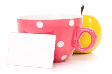 mugged: Big mug polka dot of tea and blank or empty paper with copyspace