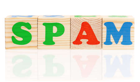 Spam word construction with letter cubes isolated on white background photo