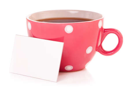 Big mug polka dot of tea and blank or empty paper with copyspace  Stock Photo
