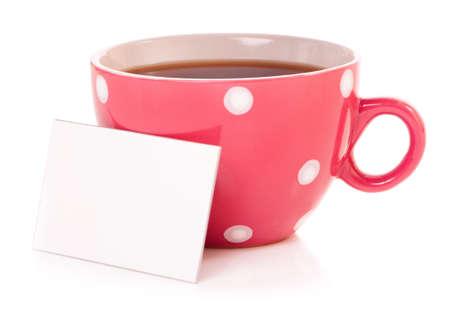 mugged: Big mug polka dot of tea and blank or empty paper with copyspace  Stock Photo
