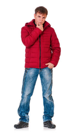 Full length portrait of a young man dressed with winter clothes isolated on white background photo