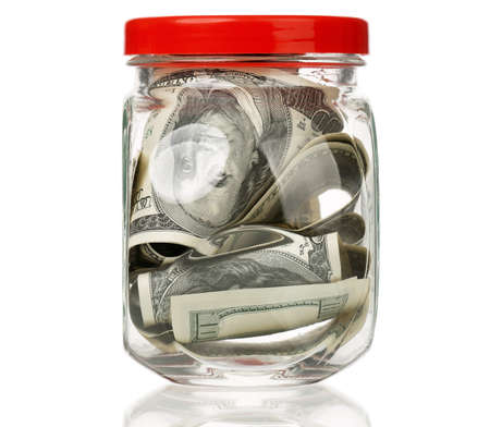 avidity: Many dollars in a glass jar isolated on white background Stock Photo
