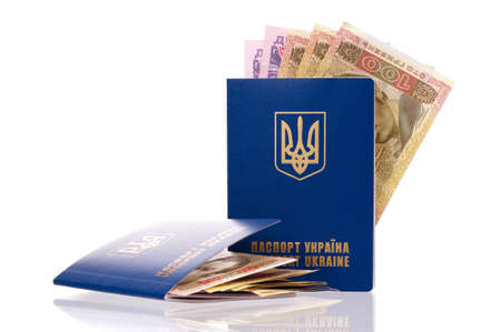 hryvna: Two international Ukrainian passport with Hryvna banknotes isolated on background