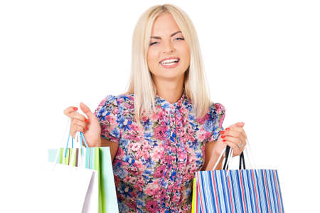 Happy woman holding shopping bags and smiling isolated on white background  photo