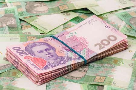 hryvna: Heap of ukrainian hryvna, on moneys background Stock Photo