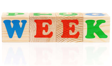 weekdays: Wooden cubes with letters makes week, isolated on white background