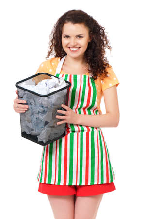 Young housewife with lots of discarded paper, isolated on white background photo
