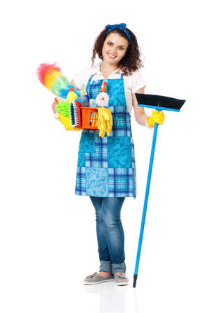 Young housewife with cleaning supplies and broom, isolated on white background photo