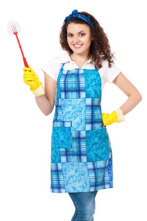 Young housewife with yellow gloves and toilet brush, isolated on white background photo