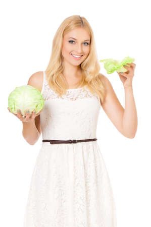 Beautiful young woman with green cabbage, isolated on white background photo